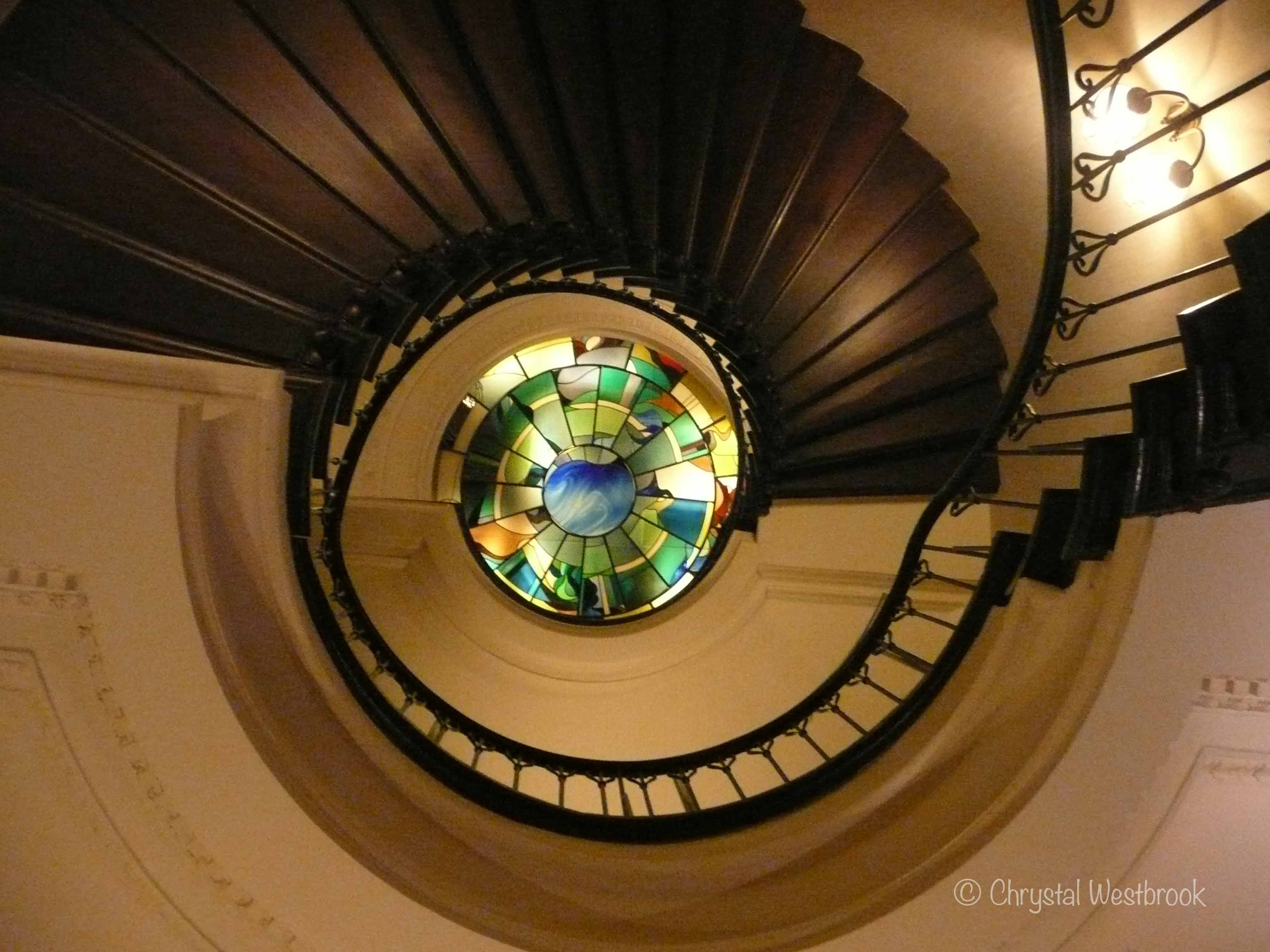 [IMAGE] Spiral staircase with stained glass