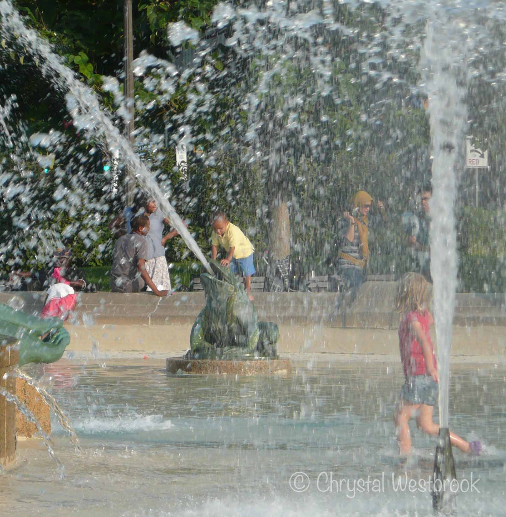 [IMAGE] Children playing in a fountain