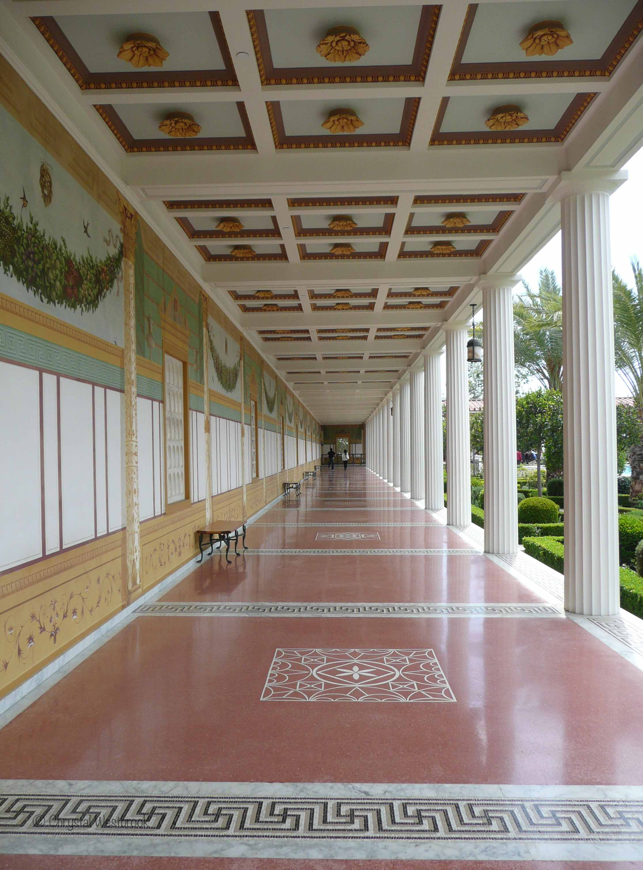 [IMAGE] Roman-style cloistered walkway with murals and coffered ceiling